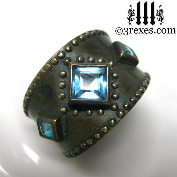 dark medieval wedding ring with gothic blue topaz