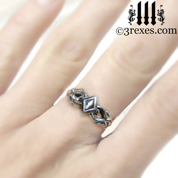 tiny princess friendship ring on middle finger