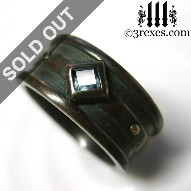 dark brass moorish gothic ring with blue topaz