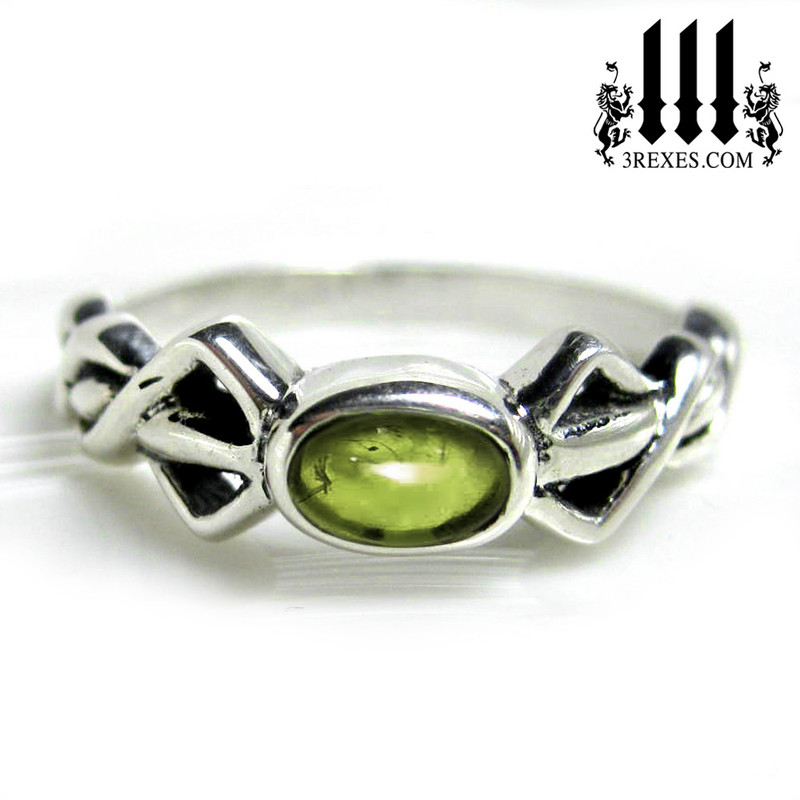 silver friendship ring with green peridot stone celtic knot