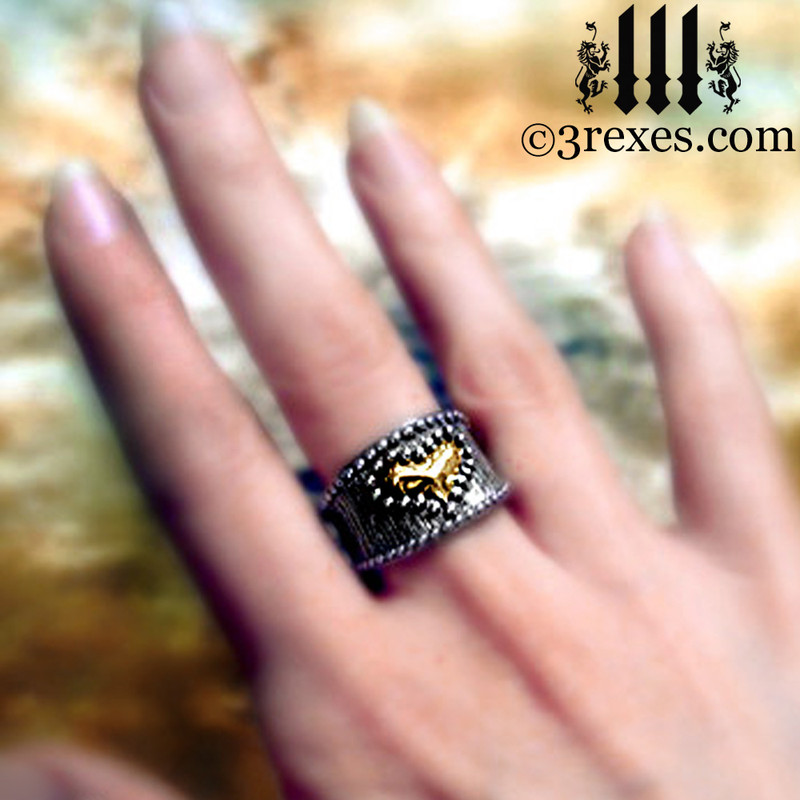 medieval studded gold heart ring on middle finger womans steam punk jewelry