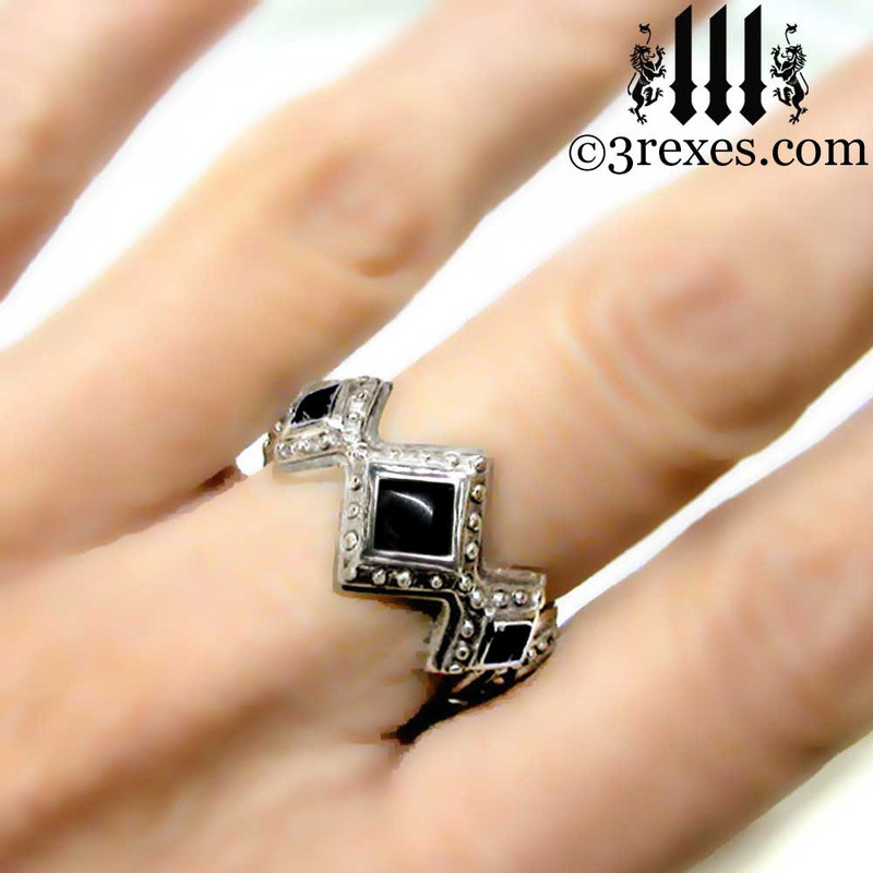 silver renaissance wedding ring on middle finger