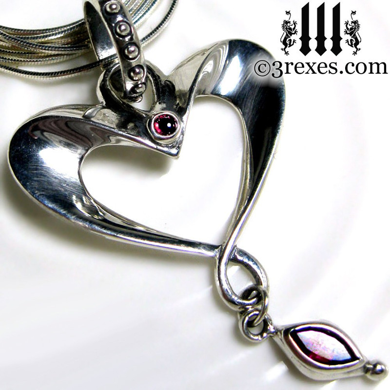eros heart necklace long snake chain with gothic garnet cabochon