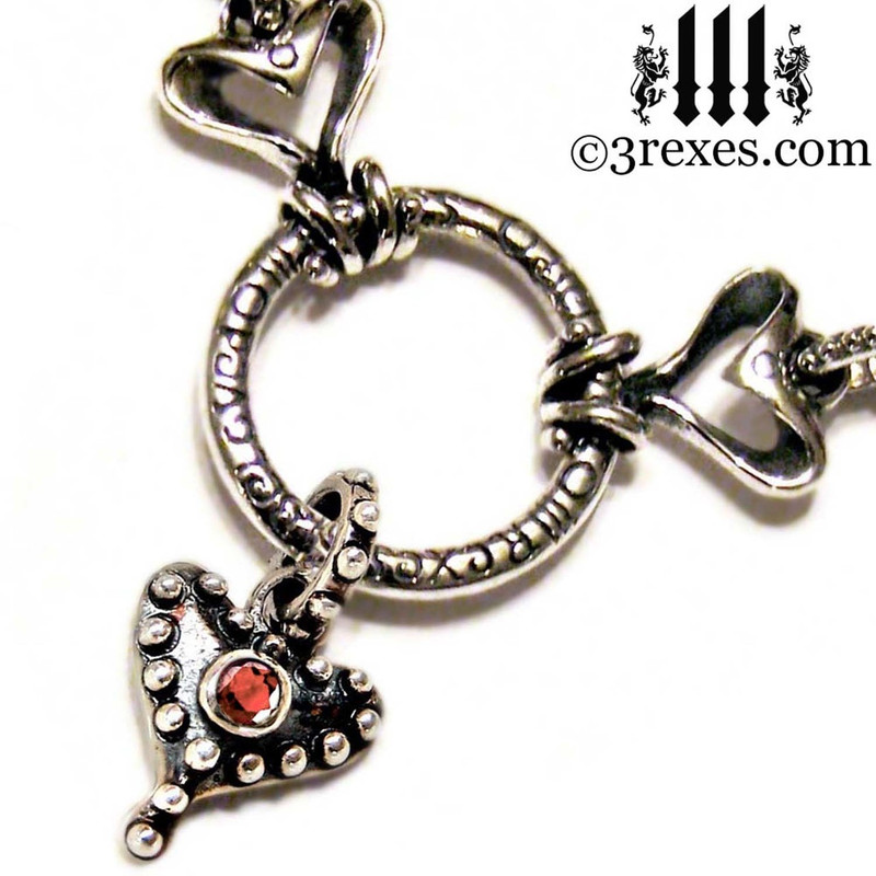 .925 sterling silver fairy tale gothic choker with studded hearts and faceted garnet