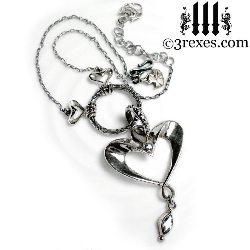 .925 sterling silver heart necklace with blue topaz stones