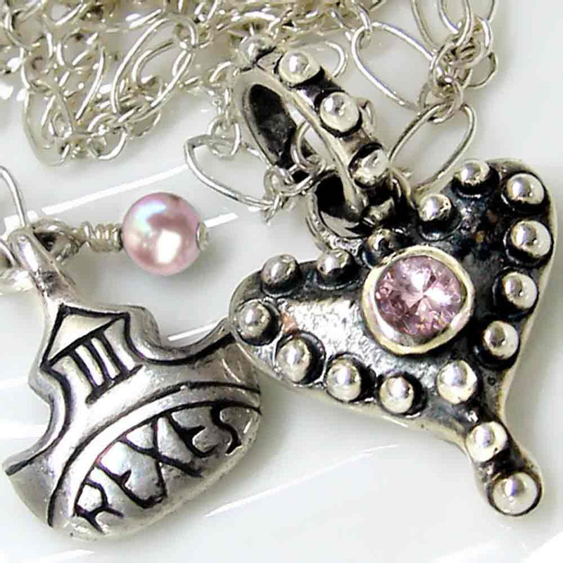 medieval fairy tale silver studded heart necklace with pink cz detail