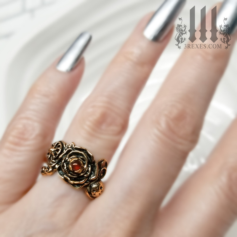 bronze full moon ring , rose ring, flower ring, sun ring with green peridot stone, gothic jewelry, fantasy designs, model view, august birthstone ring