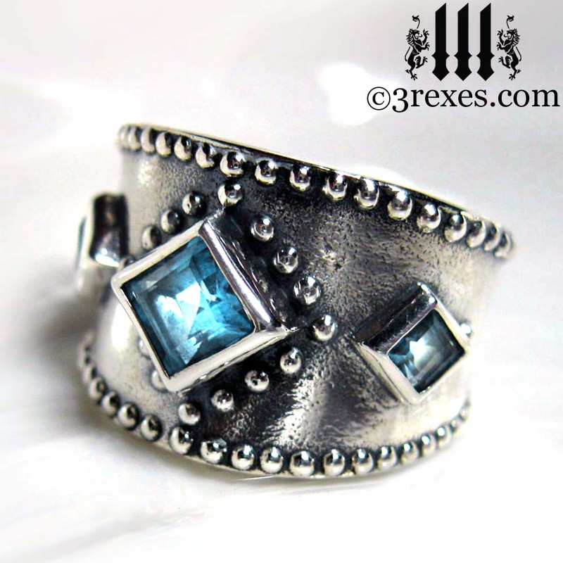 silver medieval wedding ring with gothic blue topaz stones