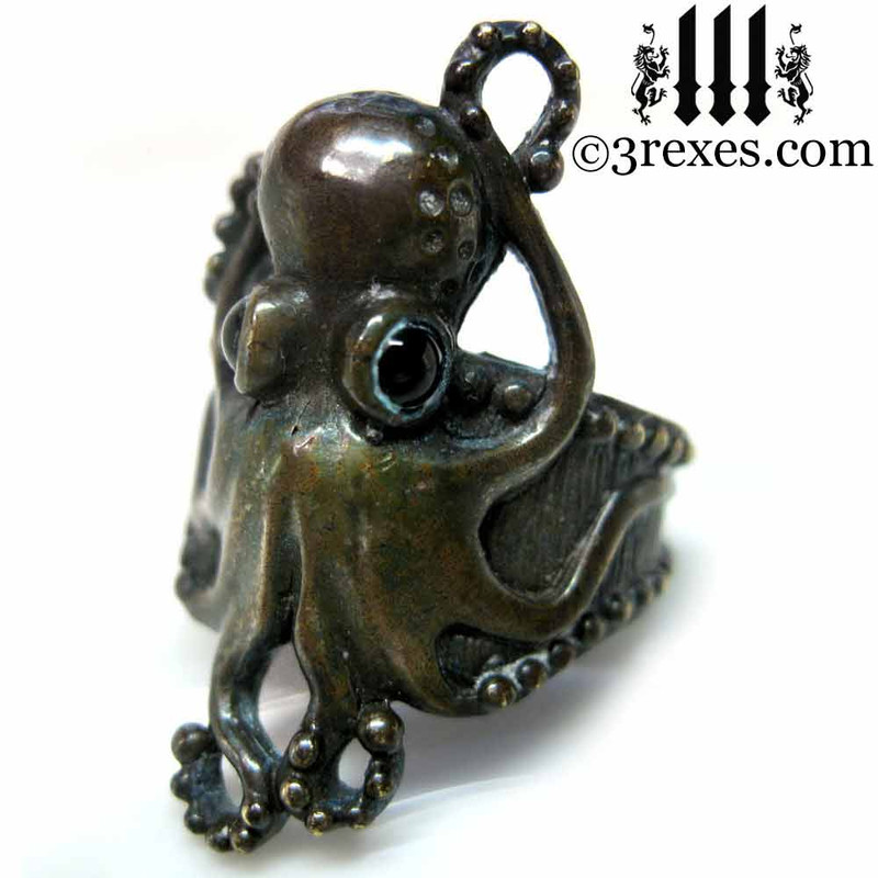 antiqued bronze octopus ring with black onyx cabochon eyes