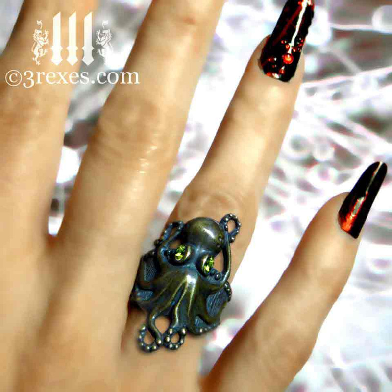 antiqued bronze octopus ring with faceted green peridot eyes model view