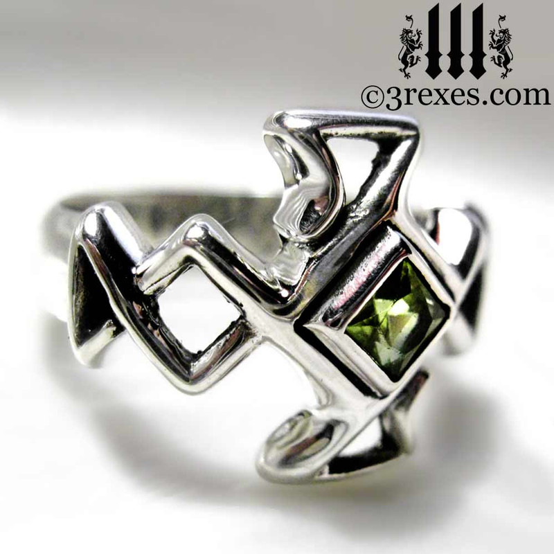 .925 sterling silver celtic cross ring with green peridot stone side