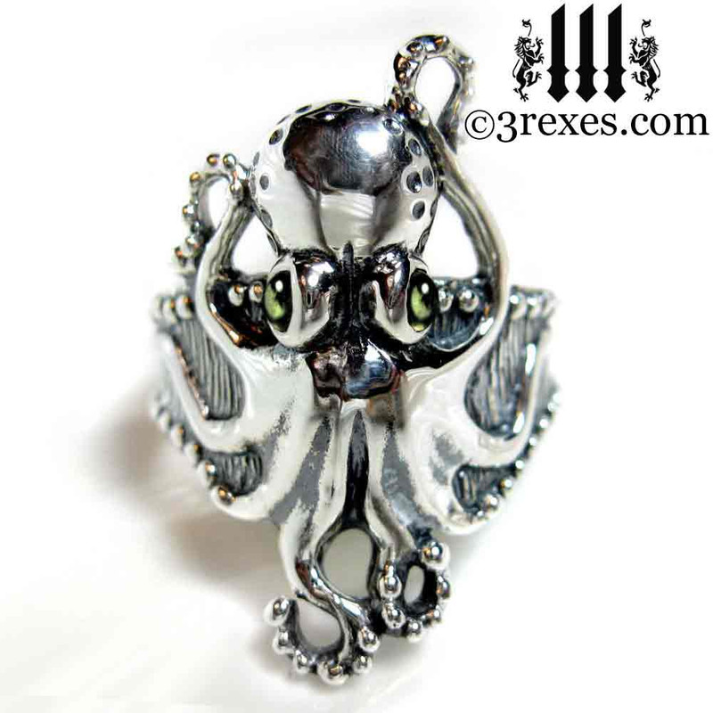 silver octopus ring with green peridot cabochon eyes