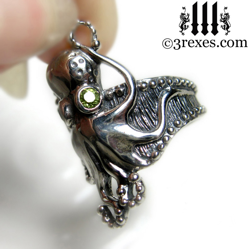 octopus ring with peridot faceted eyes