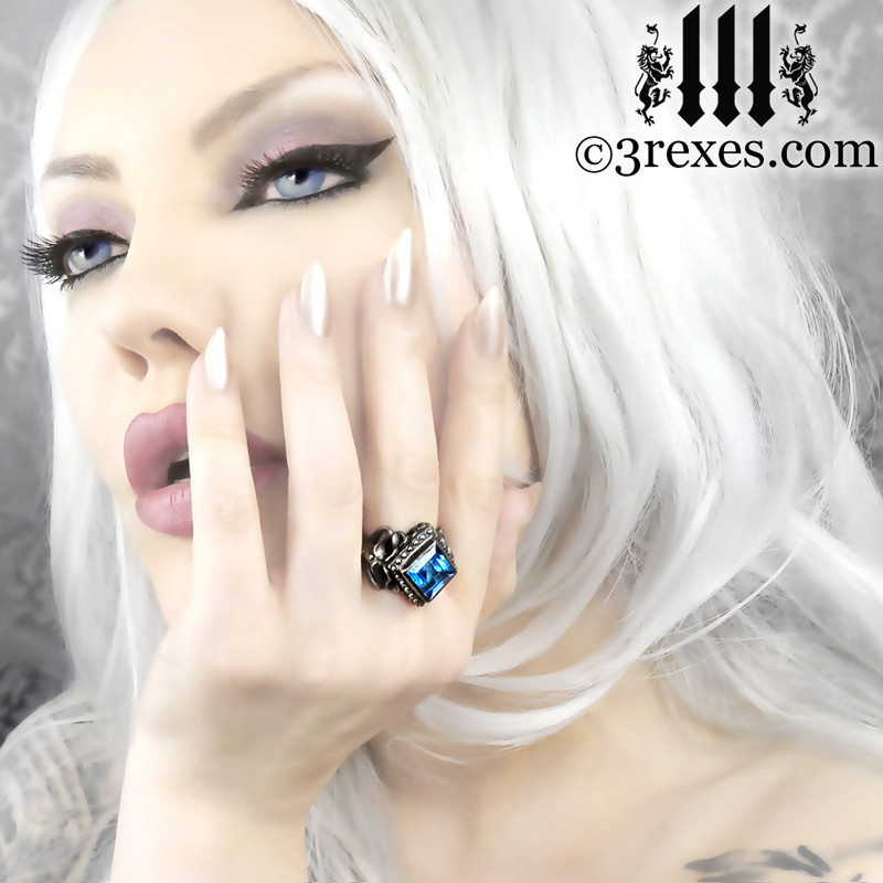 gothic raven love wedding ring with blue topaz