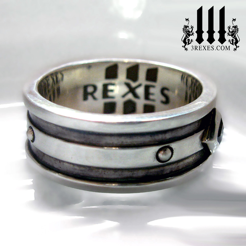 gothic wedding ring side view with silver studs and 3 rexes logo, crude band for men, guys promise crude style, dark patina