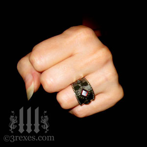 brass-3-wishes-ring-garnet-stone-medieval-gothic-wedding-jewelry-model-fist-january-birthstone