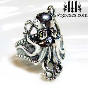 silver-octopus-dream-ring-green-peridot-cabochon-stone-eyes-studded-band-side-detail august birthstone by 3 rexes jewelry