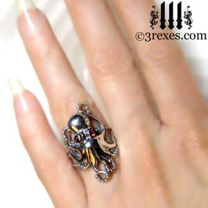 silver-octopus-dream-ring-red-garnet-stone-eyes-studded-band-hand-detail january birthstone by 3 rexes jewelry