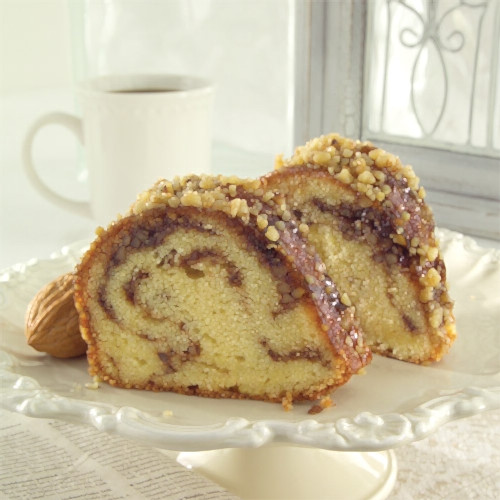 Sandy's Sour Cream Coffee Cake Buttery and full of sour cream, this bundt is ribboned with cinnamon, brown sugar and nuts, then glazed with apricots.
