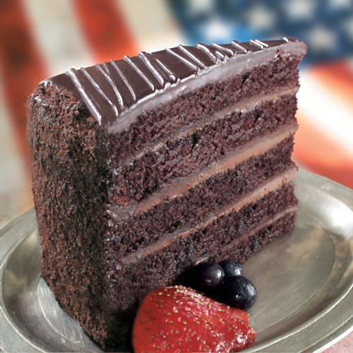 Five layers of dark, moist chocolate cake sandwiched with the silkiest smooth chocolate filling and finished with elegant dark chocolate ganache.