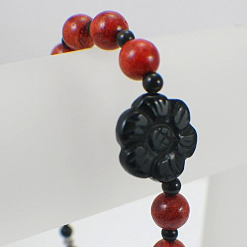 Black flower red coral bracelet 8 1/2 inch