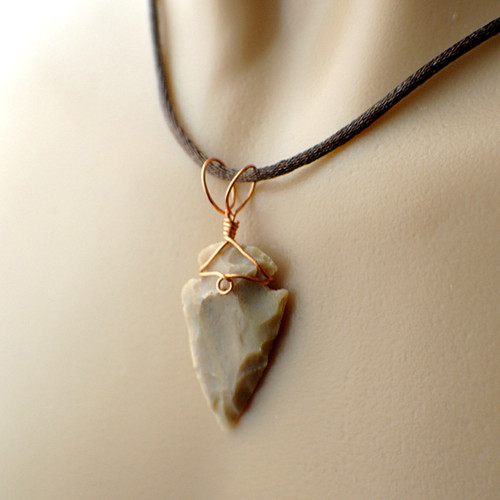 Arrowhead pendant beige wire wrapped in copper