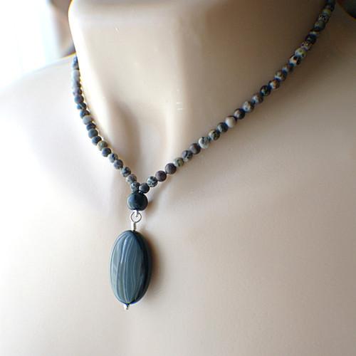 Oval black obsidian pendant necklace with slender gemstone strand