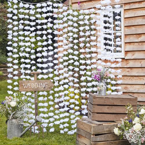 White floral petal party photo booth backdrop and rustic wedding decoration