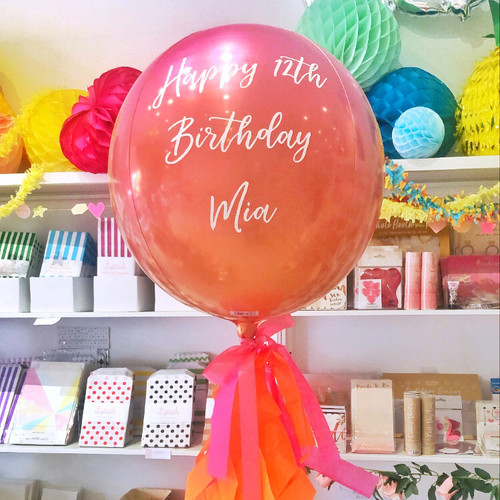 Personalised orange and pink ombre orb balloon delivered in a box direct to the recipient