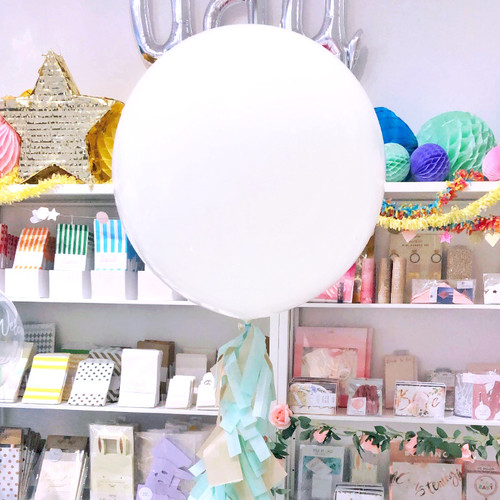 White giant latex helium balloon with a mint and beige tassel tail - perfect for baby showers and hen parties