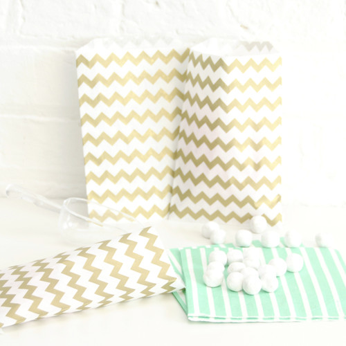 Gold chevron print paper party bags for wedding favours and goody bags