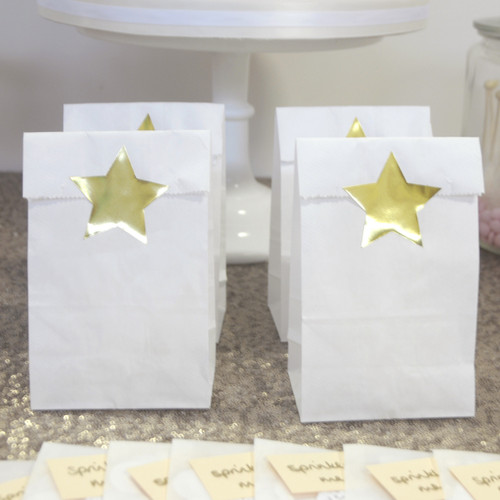Metallic shiny gold star stickers for craft projects, gift wrap finishing touches and wedding favours