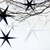 Paper star Christmas decorations in white and grey