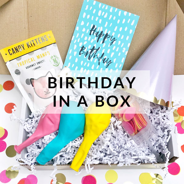 Lockdown birthday party in a box with bunting, confetti, balloons, sweets and decorations