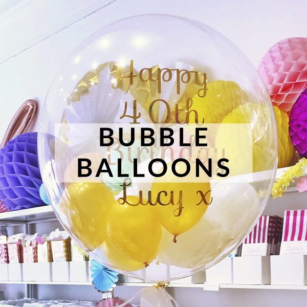 Stylish clear bubble balloons filled with confetti and mini balloons for birthday decorations and surprise gifts