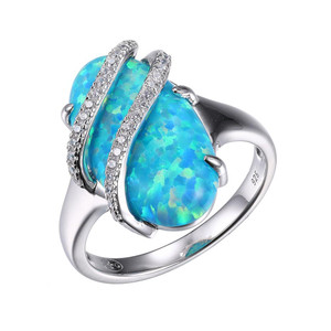 Sterling Silver Ring with Synthetic Blue Opal (Stone Size 18x10mm) and Cubic Zirconia