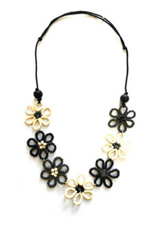 BEAD AND FLOWER NECKLACE IN BLACK AND WHITE