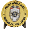 Metal challenge coin stand with pound ridge police challenge coin in the stand