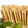 Blank bamboo straws used to laser engrave promotional logos on the outside.