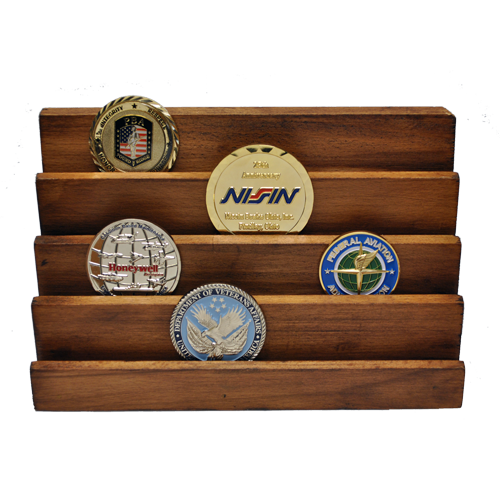 wooden challenge coin display stand that has 4 vertical rows. In this picture the stand has multiple challenge coins displayed on it to show how it looks when in use.