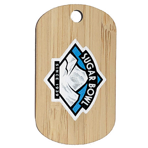Custom bamboo dog tag with sugar bowl skiing logo on it and it is oriented vertically