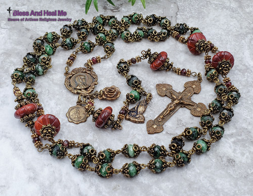 One of the Kind Blessed Virgin Mary, Assumption of Mary Ornate Heirloom Bronze Rosary with Ruby in Zoizite ,Red Jasper and Red Garnet for Protection, Happiness Joy, Passion, Faith, Hope, Loyalty, Abundance, Stress.    -Rondelle Ruby in Zoizite 8x6 mm Ave beads  - Red Jasper carved 15x6mm Our Father beads  - Bali Filigree bead caps.  Blessed Virgin Mary Assumption Ruby in Zoizite Vintage Bronze Ornate Rosary