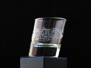 A single slanted shot glass with Julia Ashby Smyth's Ellan Vannin design - empyt