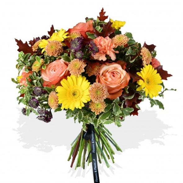 sunny yellow gerberas, peach spray chrysanthemums, dusty orange roses and orange carnations