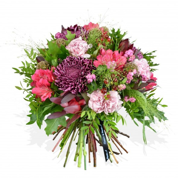Purple bloom chrysanthemums and pink carnations are crafted with pink alstroemeria