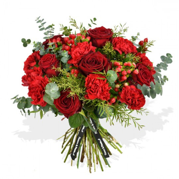 red roses and carnations flower arrangement