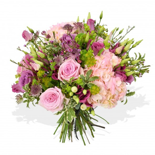 pink roses, pink lisianthus, astrantia, pink wax flower and pink hydrangea make up this bouquet