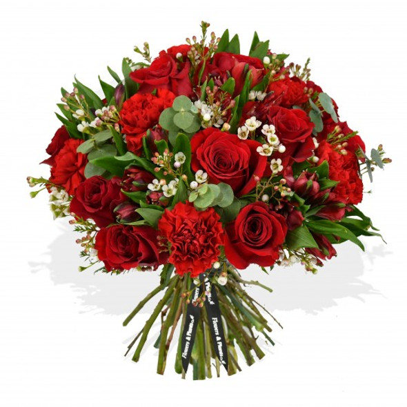 Ruby red roses, romantic carnations and crimson alstroemeria allude to a passionate devotion of love.