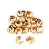 bulk pile of 3mm 12k gold filled crimp covers for diy jewelry  making.