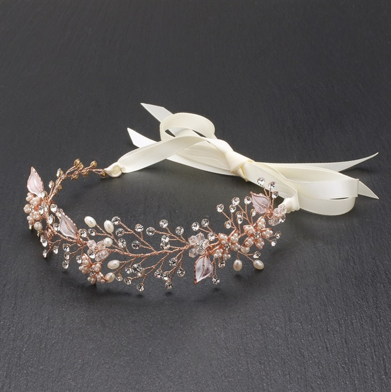 Right off the couture runway, Marielle's stunning flexible ribbon headband tiara has au courant styling. This magnificent hand-made rose gold hair jewelry with freshwater pearls.